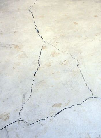 severely cracked, heaving slab floors in a home in Pequot Lakes