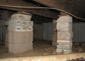 crawl space repairs done with concrete cinder blocks and wood shims in a Eveleth home