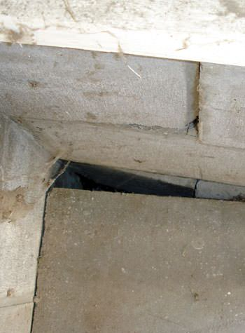 inward rotation of a foundation wall damaged by street creep in a garage in Pierz