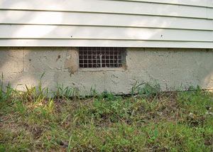 Open crawl space vents that let rodents, termites, and other pests in a home in Aitkin