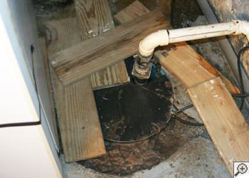 An ugly, clogged sump pump system in Cloquet, Minnesota and Wisconsin