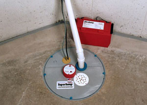 A sump pump system with a battery backup system installed in Baxter