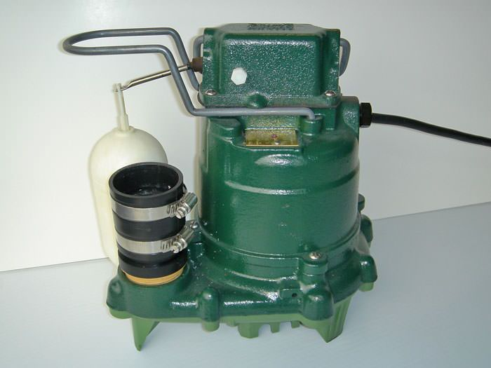 closeup of a zoeller sump pump system with a cast iron design and