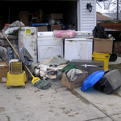 Soaked, wet personal items sitting in a driveway, including a washer and dryer in Cloquet.