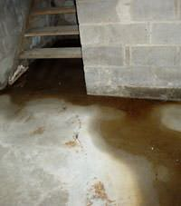 Flooding floor cracks by a hatchway door in Cass Lake