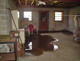 a flooded basement floor in a Nisswa home