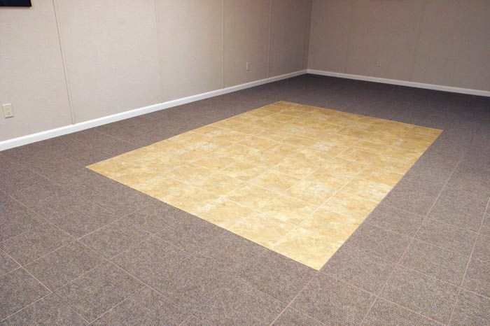 tiled and carpeted basement flooring installed in a Brainerd home